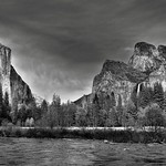 Standing on the Banks of the Merced River and Taking in an Amazing View of Mountain Peaks (Black & White, Yosemite National Park) thumbnail