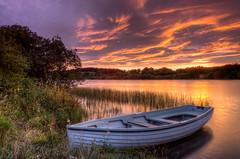 Peaceful (poach01) Tags: orangesunset loch selkirk lindeanreservoir calm boats cloudscape clouds scottishborders sunrise