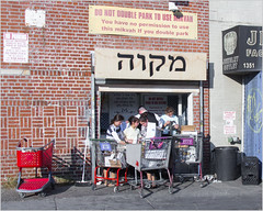 """You have no premission to use this mikvah if you double park"" (TheeErin) Tags: people shopping sign mikvah brooklyn hebrew warning street streetshot newyork unitedstates boroughpark boro park boropark girls shoppingcarts jewish entrance dunkingdishes dishesmikvah"