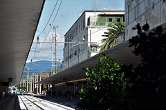 Un processo rettilineo (Milan Korenev) Tags: urban station train railway waiting people city florence italy travel transportation railroad sky clouds blue sunlight cloudscape mountain horizon architecture building