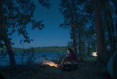 By the campfire (Nils van Rooijen) Tags: camp campfire fire travel sweden lovsjon lake canoe canoeing värmland tent girl forest warm nature landscape moonlight trees wild intothewild pinesscandinavia zweden