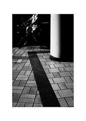 (drasticgroove) Tags: fuji xe1 summicronc 402 kitakyushu japan blackandwhite cyclist light shadow