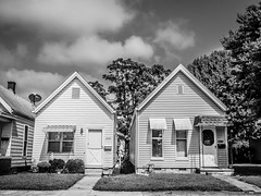 Same but different (calebbodaniel) Tags: olympus olympusomdem10markii em10markii evansville indiana evansvilleindiana micro43 m43 blackandwhite bw streetphotography neighborhood houses buildings sky clouds frontyard walking old roofs