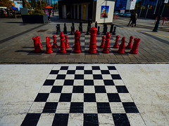 It's Chess Mate (Steve Taylor (Photography)) Tags: chess board pieces set toilets tram art picture black red white people newzealand nz southisland canterbury christchurch cbd city perspective cathedralsquare