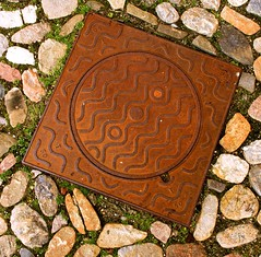 Ironic Waving (Dan Daniels) Tags: objects iron castiron manholecovers metalobjects metal geometry waves patterns audand nikon alsace ottmarsheimalsacefr france rust round square