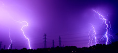 Electric Purple (J Swanstrom (Never enough time...)) Tags: purple lightning power lines electricity nikon d80 stack cloudtoground jswanstromphotography thunderstorm sky night long exposure pano ngc