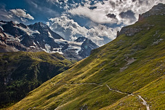 My Switzerland : Two hikers  on the high road to Obersteinberg, Canton of Bern .  23.08.17, 15:29:38, Izakigur  No. 7423 . (Izakigur) Tags: alps alpes alpen alpi berneroberland bern berne berna ch helvetia liberty izakigur flickr feel europe europa switzerland schwyz suïssa suiza suisse suisia schweiz romandie suizo swiss svizzera سويسرا laventuresuisse lepetitprince myswitzerland landscape dieschweiz lasuisse musictomyeyes nikkor nikon climbeverymountain hiking breithorn lauterbrunnen topf25 100fvaes 500faves 750faves