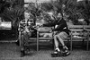 Mister Flowers and Friend (gwpics) Tags: catalonia rollerblades man outdoors skates barcelona mono outside leisure streetphotography black spanish spain sitting people hangingout lifestyle male men monochrome person socialcomment socialdocumentary society bw blackwhite blackandwhite exterior