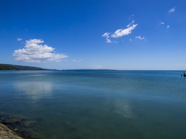 Coastline under blue sky