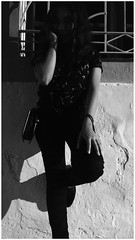 The Sola returns (Esaú Alberto Canto Novelo) Tags: girl shadows streetphotography merida blackwhite wall phone alone mexico blancoynegro woman black womaninblack