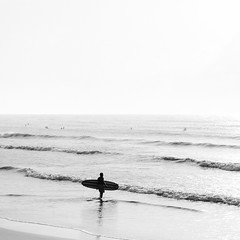 Surfer (Mabry Campbell) Tags: 2012 august brazoriacounty surfside surfsidebeach tx texas us usa unitedstates unitedstatesofamerica blackandwhite coast coastal fineart fineartphotography image monochrome people photo photograph photography seascape sport squarecrop surfer water waves f35 mabrycampbell july 2017 july152017 20170715campbellh6a5678 100mm ¹⁄₁₀₀sec 8000 ef100mmf28lmacroisusm fav10 fav20
