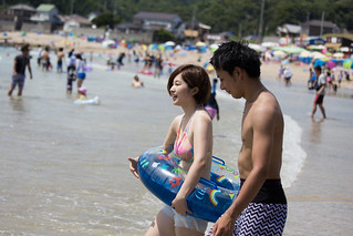 young couple walking into the sea
