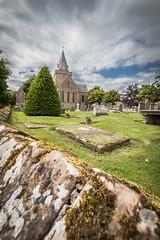 Dornoch Cathedral (MBDGE) Tags: dornoch canon70d cathedral green wall scotland alba tree stone grave