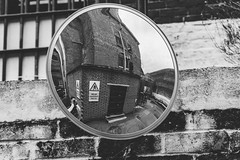 mirrored (enteryourscreenname) Tags: mirror convex self portrait canterbury prison bw black white greyscale bokeh blackandwhite architecture outdoors urbanscene buildingexterior famousplace europe old builtstructure history city wallbuildingfeature