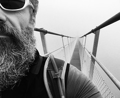 The Hiker (Toni_V) Tags: iphone selfie suspensionbridge hängebrücke europaweg grächenzermatt wallis valais blackwhite bw monochrome sep2 niksoftware me perspective fog nebel mist hiking wanderung switzerland schweiz hängebrückeranda charleskuonenhängebrücke ©toniv 2017 170812