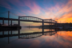 Good Morning Saltash (Timothy Gilbert) Tags: saltash sunrise bridge royalalbertbridge reflection panasonic boats olympus918mmf4056 clouds summer river wideangle nikcollection ultrawide tamar gx8 cornwall tamarbridge reflections