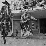 Vietnam War - Hue, 10 Feb 1968 - Vietnamese Soldier Faces Giant Gunfighter Display - Photo by Dana Stone thumbnail
