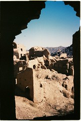 Kharanaq, Iran - Window (grassybrownie) Tags: landscape scenery mountain mountains monochrome film kodak camera village fields sky skyline skyporn houses oldhouse old ontheroad house buildings building nature nofilter natural blue yellow sand dirt art arts earth architecture architect sun shadow sunshine sunset sunlight light dark green clor colorful colors cold winter window door wall white lomography lomo kharanaq iran persia persian iranian photography photographer photo