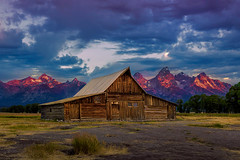 Molton Barn Sunrise (NickSouvall) Tags: molton barn mormon row grand teton national park wyoming sunrise bright light blue clouds hour morning red pink orange alpenglow glow mountains peaks mountain peak range face landscape nature wild wilderness photo picture photography photos hike hiking adventure explore discover