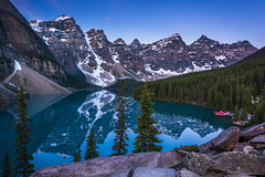 Calmness (inkasinclair) Tags: lake moraine louise calm calmness sunrise blue hour mountains peaks 10 ten water reflection rock pile rocks trees conifers conifer snow ice glacier boat boats still reflections reflect canada alberta landscape nature photography nikon d810 travel