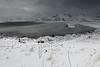 E-SEwards view to Ytresand beach-Sandbotnen bay. Volandstinden-Sautinden-Nonstinden-Stortinden-Moltinden-Flakstadtinden mounts. Moskenesoya-Flakstadoya-Lofoten-Norway. 0399 (rweisswald) Tags: coast bay beach seaside rockyshore seashore foreshore cove inlet bight ytresand yttersand sandbotnen fredvang estuary sandelva sandoya view landscape seascape sandbar white snowy snowfall snowblanket snowcovered snowcappedmountain storm stormysky cloudy overcast misty darkwater sea wave peak moskenesoya volandstinden sautinden nonstinden stabben pilten stortinden moltinden flakstadtinden hustinden flakstadoya lofoten nordlandfylke norway