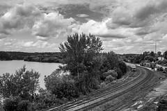 Huntsville Railway Station (Rainfire Photography) Tags: train station railway huntsville ontario muskoka cottagecountrytravel trip landscape tracks summer heritage monochrome blackandwhite water