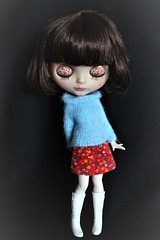 Blue mohair sweater and floral mini skirt