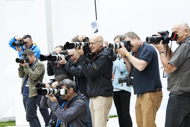 Press pack gather to snap an author
