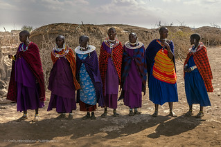Masai women waiting for visitors at the gate to their village, Maasai Mara, Tanzania, June 2017