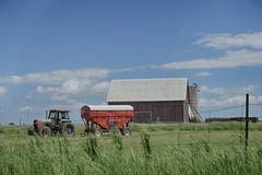 Red Wagon (gabi-h) Tags: bigisland redwagon tractor fence fencefriday bluesky clouds grass princeedwardcounty gabih barn silo farm farmmachinery rural rustic blue