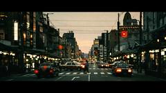 Shijo Dori, Kyoto, Japan (emrecift) Tags: cityscape candid street lights kyoto japan analog 35mm film photography cinematic grain 2391 anamorphic crop canon ae1 program new fd 50mm f14 cinestill 800t kodak vision 3 cinema emrecift