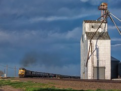 UP's Overland Route at Pine Bluffs (rolfstumpf) Tags: usa wyoming pinebluffs unionpacific grainelevator freighttrain trains railway railroad olympus e5 sky clouds smoke transportation grain agriculture