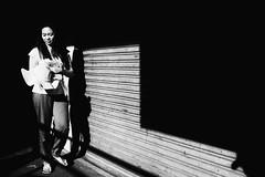 Peeking Out (Meljoe San Diego) Tags: meljoesandiego fuji fujifilm x100f streetphotography light shadow candid monochrome philippines