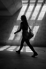 Rather walk alone in the darkness than follow anyone elses's shadow. (Markus Binzegger) Tags: markus binzegger blackandwhite em10 fotografie markusbinzegger monochrome omd olympus photography street streetfotografie streetphotography black white girl silhouette shadow walking