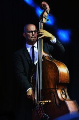 Bass Player (Poocher7) Tags: bassist doublebass concert musician music people portrait stagelights bald glasses bluelights male jazz liveconcert jazzmusic waterloojazzfestival waterloo ontario canada