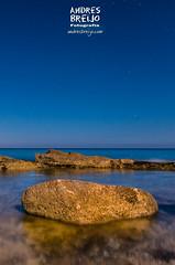 La cola del Dragon2 (Andres Breijo http://andresbreijo.com) Tags: playa mar sea beach rocas rocks noche night cielo sky estrellas stars formentera baleares españa spain