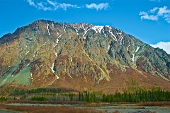 Scarred Beautifully (Herculeus.) Tags: ak alaskarange clouds country day denalinp evergreens ice landscape landscapes mountains outdoor outdoors outside peaks river snow spring talkeetnatodenali trees valley mountain tree forest sky wood grass 5photosaday mountainside water field