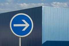 One way in blues (Jan van der Wolf) Tags: traficsign sign trafficsign onewaysign blue blauw monochroom monochrome verkeersbord eenrichtingsverkeer building gebouw 158197