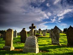 Graveyard at Saint Ciaran's Church (burnsmeisterj) Tags: olympus omd em1 stonehaven cemetery graveyard gravestones sky clouds shadows