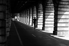 Between arcs (pascalcolin1) Tags: paris13 bercy homme man arches arcs pont bridge lumière light shadows ombres soleil sun photoderue streetview urbanarte noiretblanc blackandwhite photopascalcolin