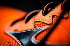 Run for Your Life (photoben37) Tags: macro monday shoes orange run staying healthy stayinghealthy macromondays nikon d7000