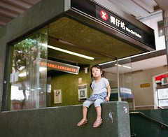 i put Genie sitting on the entrance of a subway station while we're waiting for the bus (SiuDull) Tags: pentax67ii pentax67 portra400 girl memories 6x7 subway green color colour cute moment children kid eugenie genie commute station mtr light available portrait wanchai 灣仔 香港 hongkong portra kodak kids child childhood candid hs1800 noritsu sooc format medium analog film 120 f28 75mm smc pentax