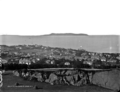 General View, Dalkey, Co. Dublin (National Library of Ireland on The Commons) Tags: robertfrench williamlawrence lawrencecollection lawrencephotographicstudio thelawrencephotographcollection glassnegative nationallibraryofireland dalkey codublin hills rocks hayricks houses islands dalkeyquarry dublinbay loretoabbey locationidentified countydublin castlestreet village howthhead 1890s