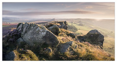 Moorland and Rocks (Dave Fieldhouse Photography) Tags: ramshawrocks peakdistrict staffordshire staffordshirelife staffordshiremoorlands moors moorland rocks morning dawn sunrise outcrop shadows farmland road a53 national park nationalpark landscape stitchedpanorama panorama outdoors countryside heather wildflower grasses clouds mist wwwdavefieldhousephotographycom fuji fujifilm fujixt2