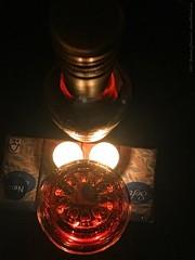 Staring at intoxication (dksesh) Tags: seshadri dhanakoti harita appleiphone7 appleiphone iphone7 sesh seshfamily haritasya hevilambisamvatsara apple iphone guiltypleasure wine kooliburra australian candle light