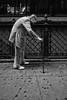 pavement with chewing gum and man (Peter du Gardijn) Tags: manhattan man oldman walkingstick chewinggum whiteshoes pavement newyork usa portrait streetportrait streetphotography blackandwhite pattern fujifilmx100 fujifilm portraitofanoldman old