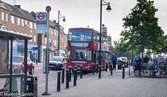Collier Row Shops (M C Smith) Tags: pentax k3 bus driver shops trees green blockpaving bollards lamps signs busstop busshelter people sitting bench railings bin waiting trafficlights flats