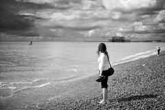 Day Dreaming (Foto John) Tags: leicam leicam240 leica leicamtyp240 rangefinder summicronm50mmƒ2iv blackwhite blackandwhite blackandwhitethatsright monochrome streetphotography beachphotography beach candid woman people brighton uk