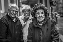 The Winter of Life (Leanne Boulton) Tags: groupshot people monochrome portrait urban street candid portraiture streetphotography candidstreetphotography candidportrait streetportrait eyecontact candideyecontact streetlife sociallandscape old age elderly woman female man male faces face facial expression look emotion feeling mood eyes atmosphere skin wrinkles ageing wig tone texture detail depthoffield bokeh dutchangle naturallight outdoor light shade shadow city scene human life living humanity society culture canon canon5d 5dmarkiii 70mm character ef2470mmf28liiusm black white blackwhite bw mono blackandwhite glasgow scotland uk