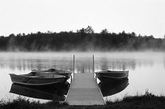 Edit -1-31 (Dane Van) Tags: minolta xg1 ilford hp5 ilfordhp5 blackandwhite ccr canadacreekranch atlantamichigan sunrise fog dock boats lakegeneva
